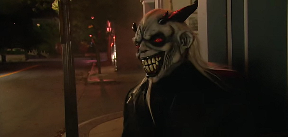 A still image from the movie Satan's Little Helper, of a man wearing a devil costume