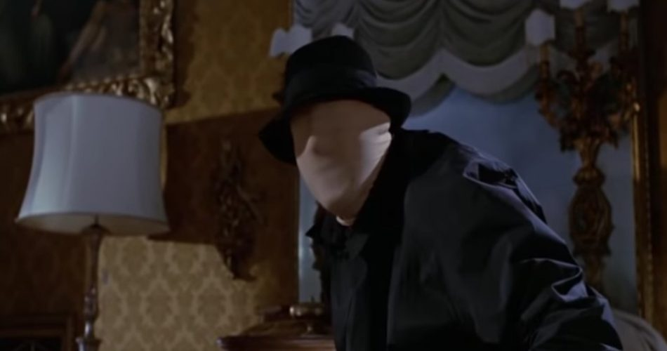 A screen shot taken from the film Blood and Black Lace. It shows a man in a white mask.