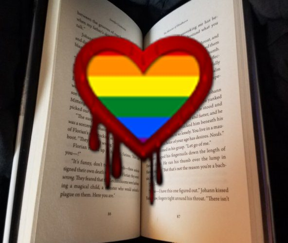 LGBTQ+ horror with a rainbow hear dripping with blood over a book