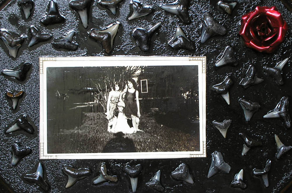 shark zombies old photograph and shark teeth collage with metal rose on wood panel