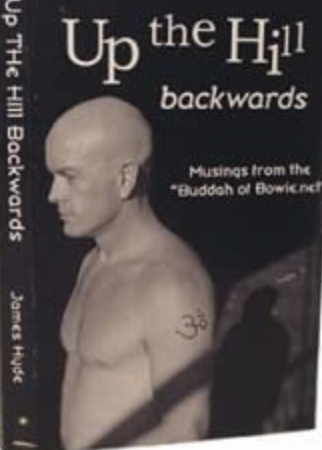 Picture of a bald man looking chiselled and intent. Jim Hyde's book Up the Hill Backwards