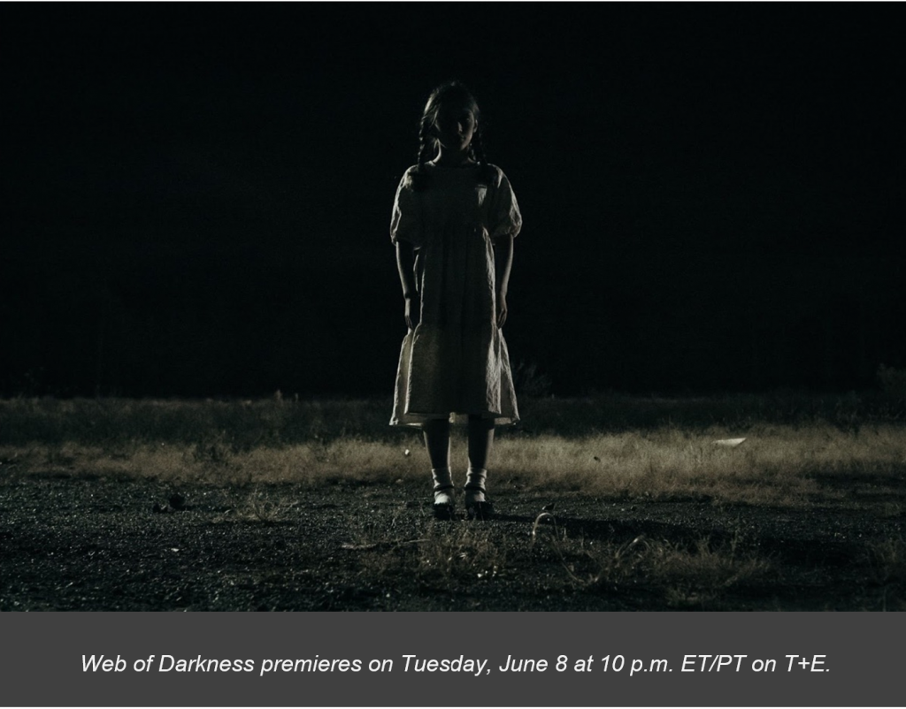 Web of Darkness promo with a girl in an old-fashioned dress standing alone in the middle of a dark field