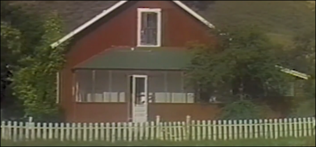 Still from the movie Sledgehammer depicting a house