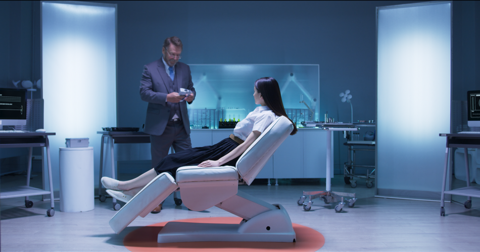Picture of a young woman strapped to a medical chair as an old doctor looking guy comes towards her. Picture from Deep