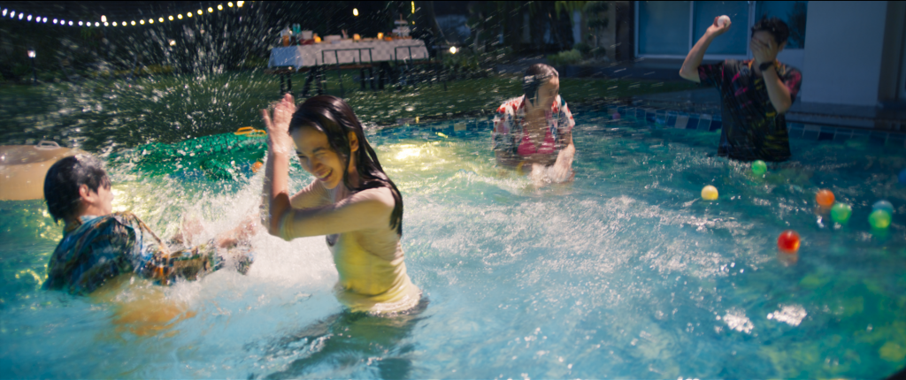 Teens in a pool with clothing on and splashing around (The Deep)