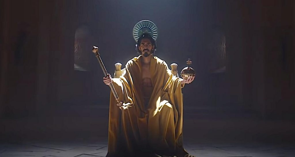 A still of Dev Patel in royal, Christ-like regalia from 2021's The Green Knight